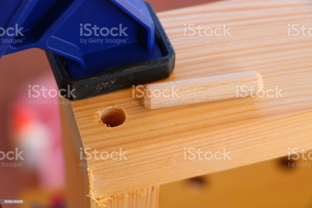 Gluing dowel joint stock photo