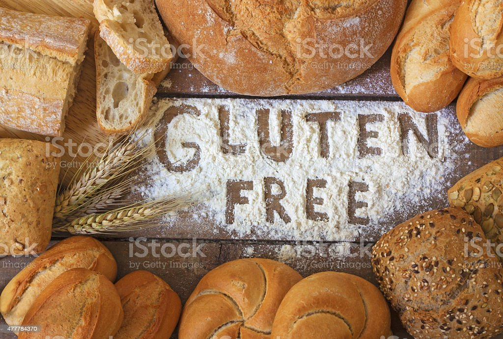 gluten free breads on wood background stock photo