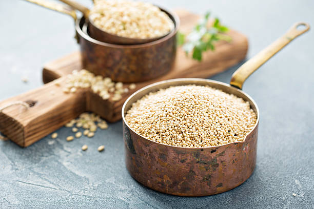 gluten free cooking with quinoa - quinoa stock photos and pictures