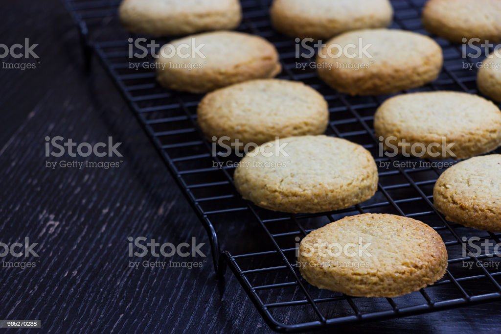 Gluten free fitness homemade oats oatmeal cookies on cooling rack. Wooden black background. Copy space. zbiór zdjęć royalty-free