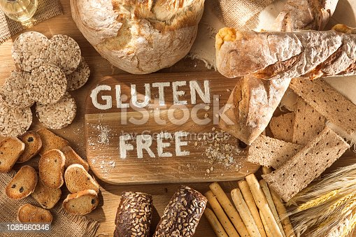 istock Gluten free food. Various pasta, bread and snacks on wooden background from top view 1085660346