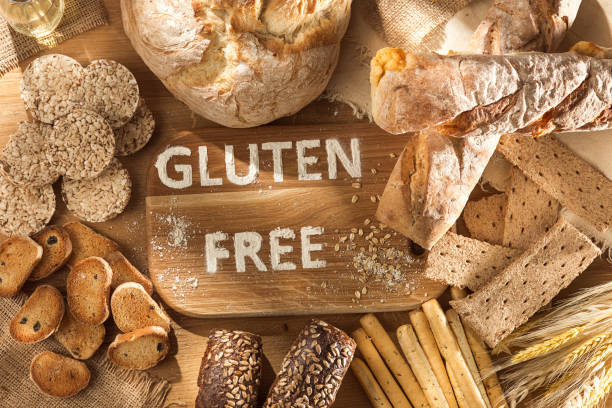gluten free food. various pasta, bread and snacks on wooden background from top view - тесто стоковые фото и изображения