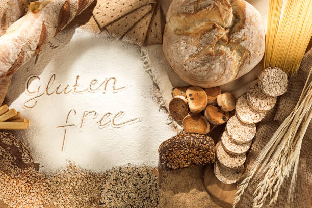 gluten free food. various pasta, bread and snacks on wooden background from top view - impasto foto e immagini stock