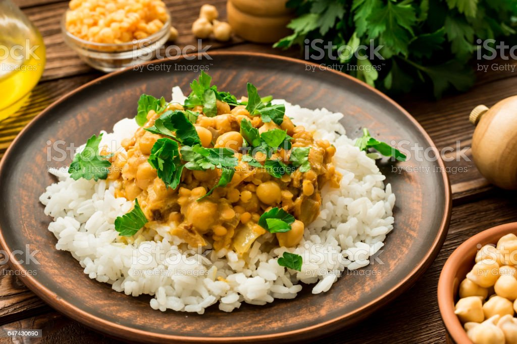 Gluten free rice and vegan chickpea curry stock photo
