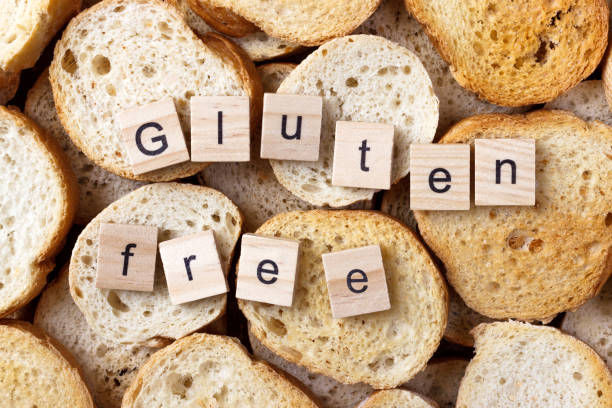 gluten free text on background from many small round rusks. top view - impasto foto e immagini stock