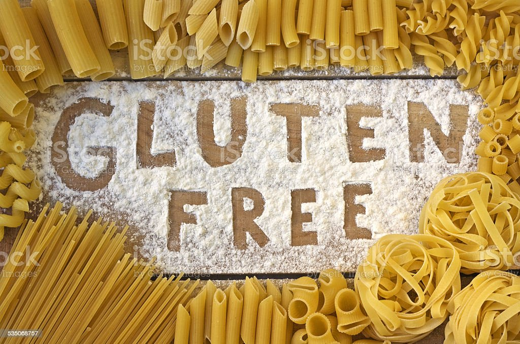 gluten free word with wood background stock photo