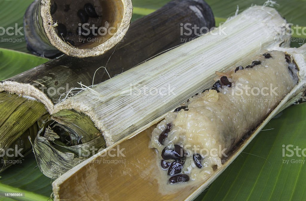 Glutinous rice roasted in bamboo joints royalty-free stock photo