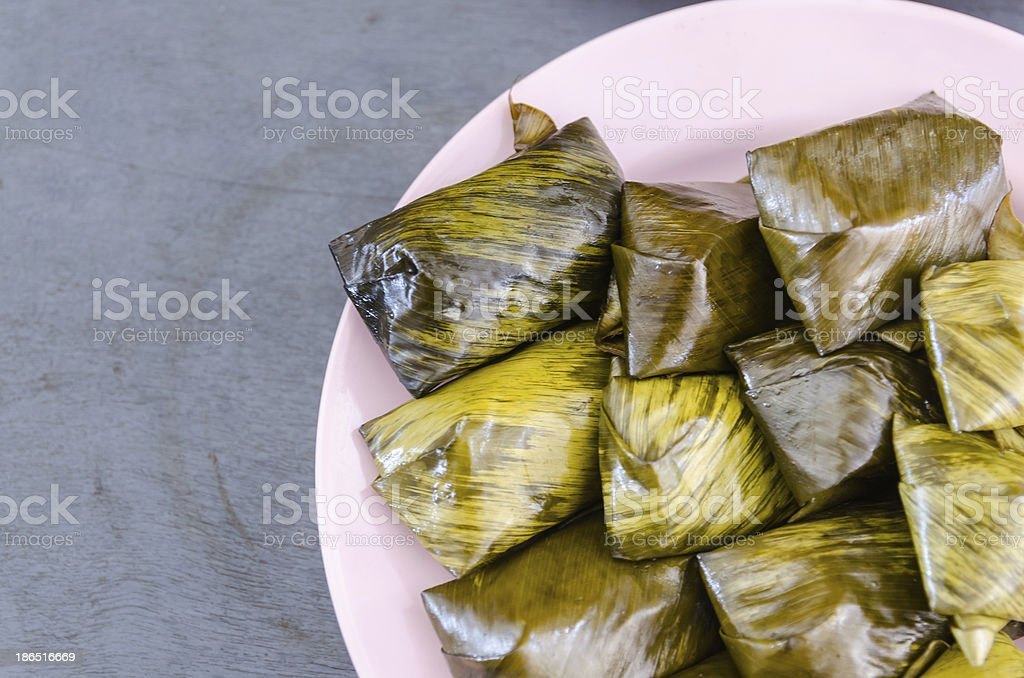 glutinous rice steamed in banana leaf royalty-free stock photo