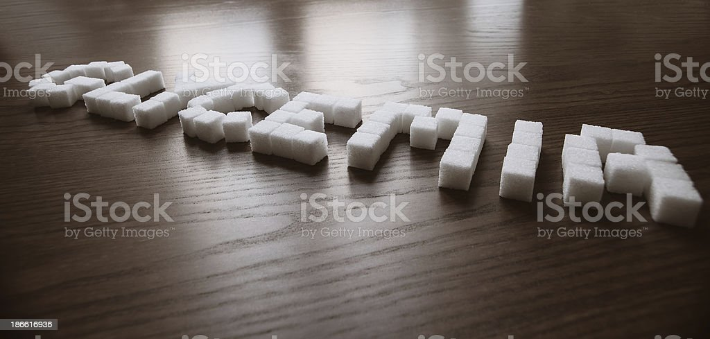 Glycemia written with sugar cubes stock photo
