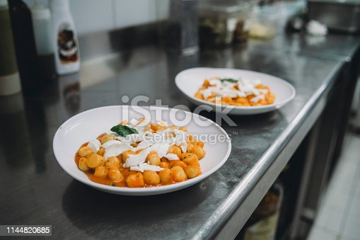 Gnocchi plates are ready in the restaurant's kitchen
