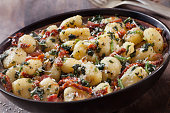 Gnocchi with Crispy Pancetta, Sun dried Tomatoes, Spinach and Parmesan Cheese in a Brown Butter Sauce