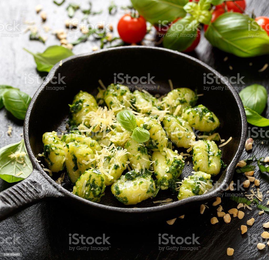 Gnocchi with herb pesto, delicious Italian vegetarian dish stock photo