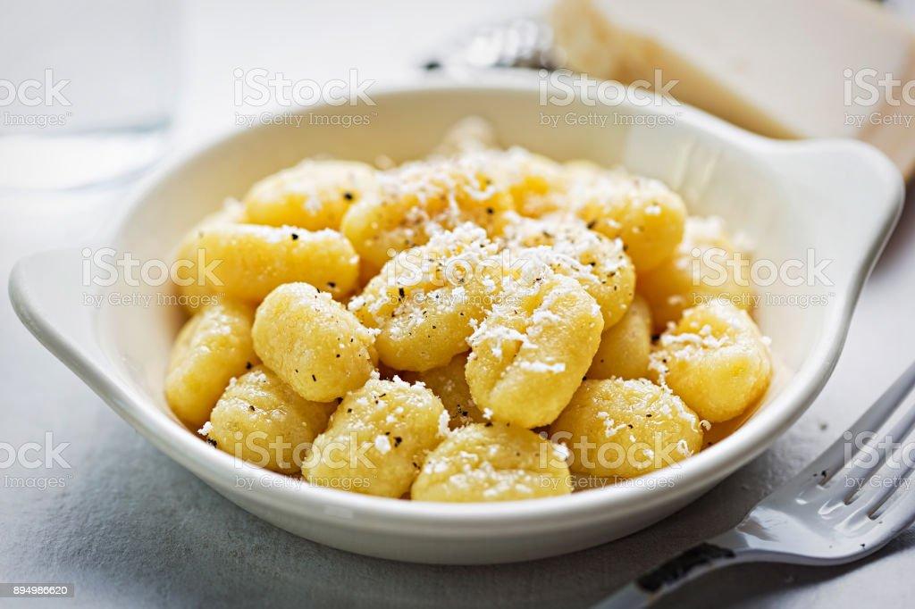 Gnocchi with parmesan stock photo