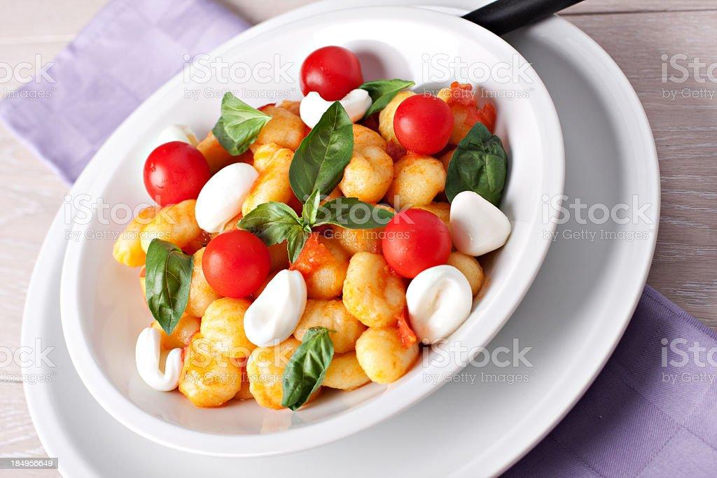Gnocchi with tomato mozzarella and basil royalty-free stock photo