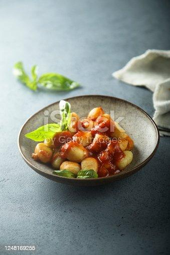 Homemade potato gnocchi with tomato sauce