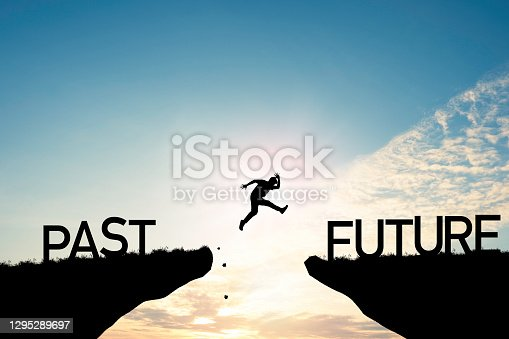 Go ahead and continuously improvement concept, silhouette man jump on a cliff from past to future with cloud sky background.