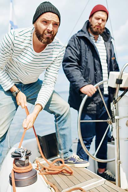 Go alongside! Seamen mooring alongside ship sailor suit stock pictures, royalty-free photos & images