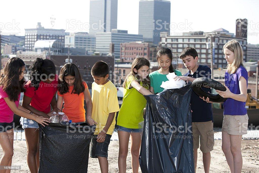 Go Green Ethnically Diverse Children Clean Tash From Urban ...