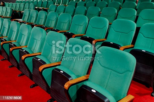 istock Go green for sitting and watching pictures. Placed in multiple locations in the theater. Taken from the side. 1152618606