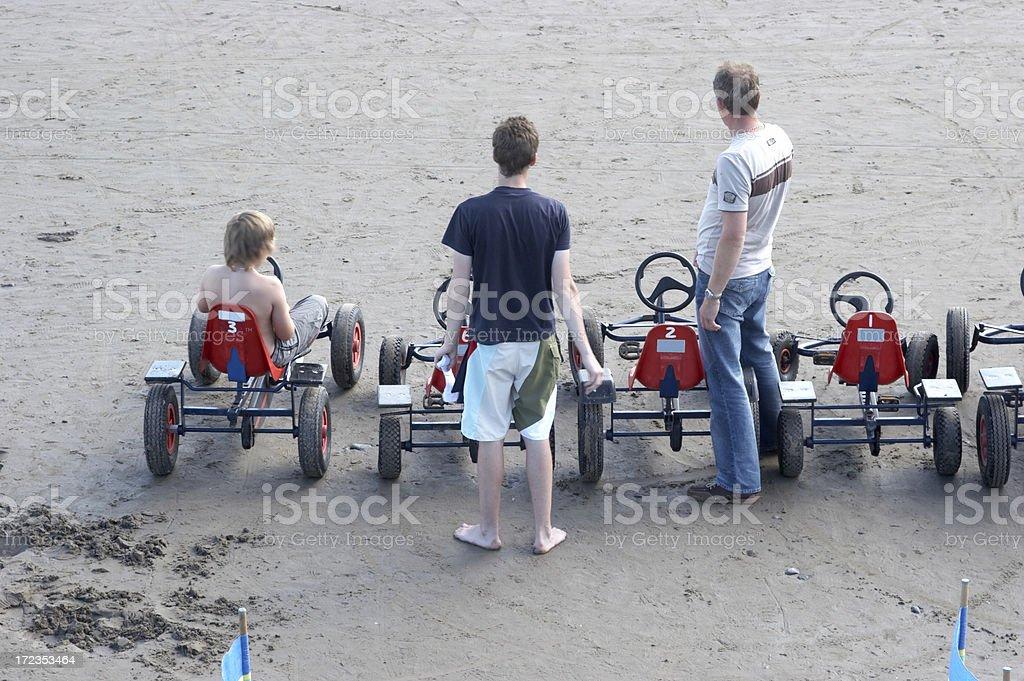 Go karts on the beach three boys royalty-free stock photo