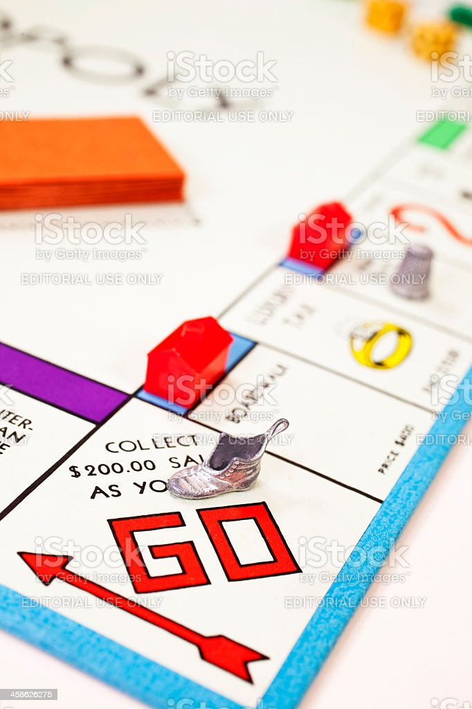 Go on a monopoly board with shoe and thimble royalty-free stock photo