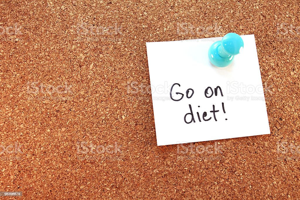 Go On Diet Note Tacked To Corkboard royalty-free stock photo