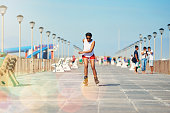Shot of an attractive young woman rollerblading on a boardwalk