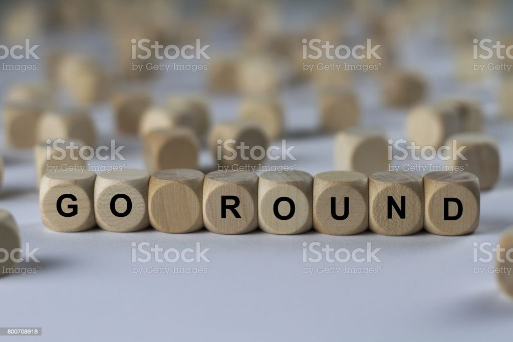 go round - cube with letters, sign with wooden cubes stock photo
