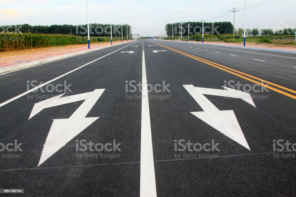 go straight and turn arrow on the asphalt road, closeup of photo royalty-free stock photo