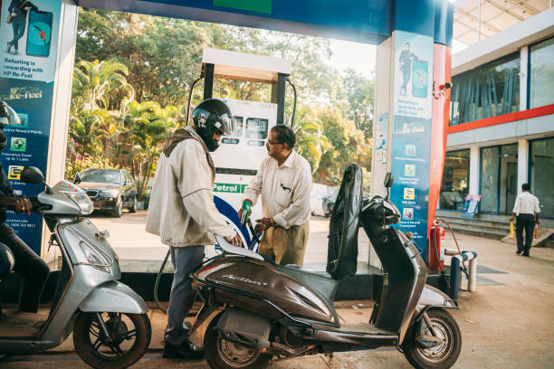 Goa, India. Scooters Are Refueling At Hp Petrol Pump stock photo