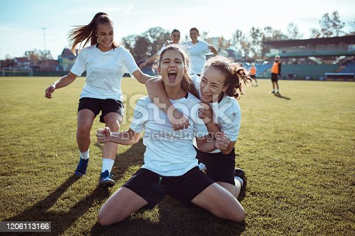 Close up of a female soccer team celebrating a scored goal