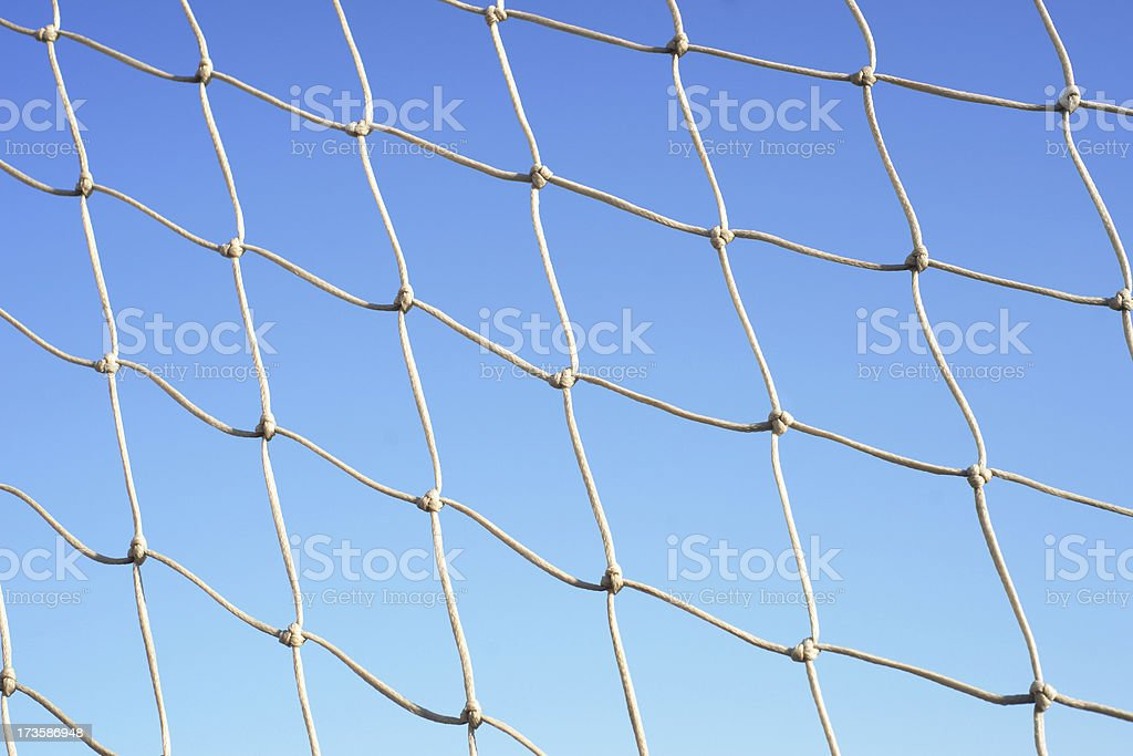 Goal net against cloudless sky royalty-free stock photo