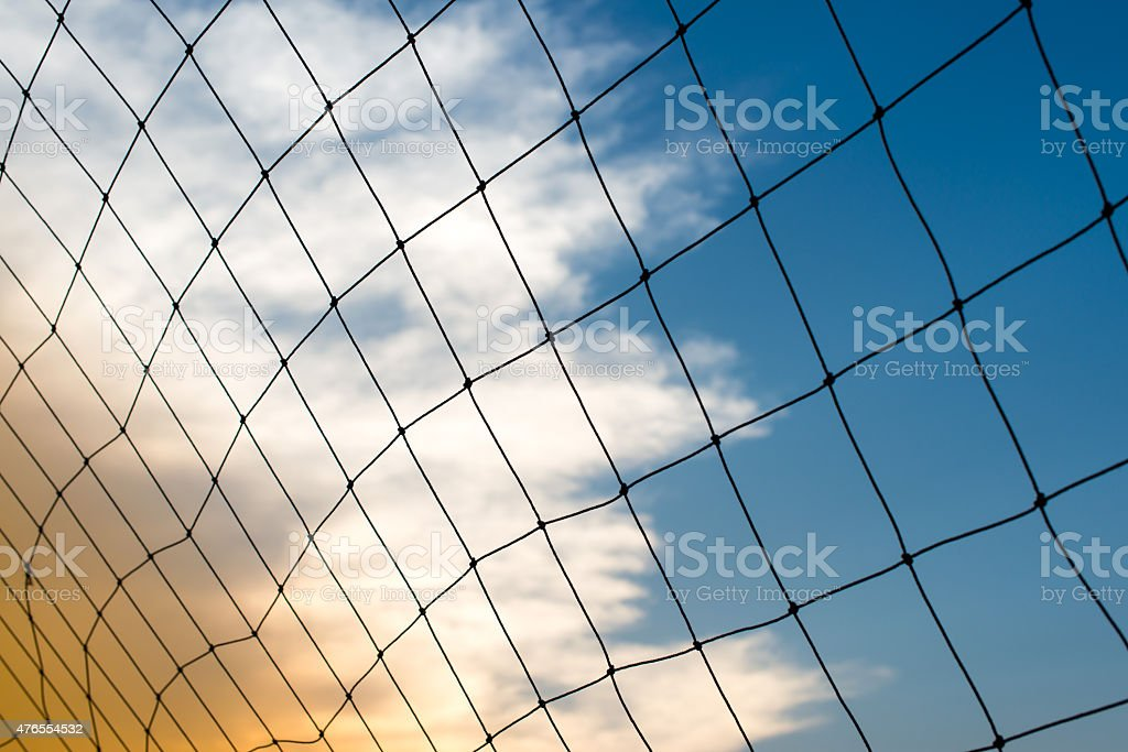 Goal net in the sunset stock photo