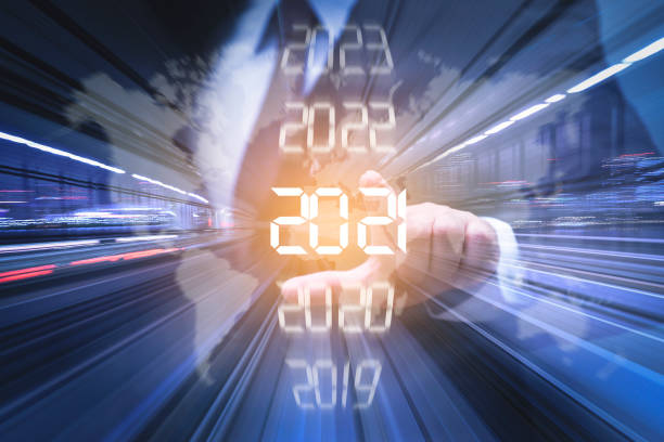 Goal of 2021 New year combined futuristic concept, Businessman pointing at year 2021 forecasting stock pictures, royalty-free photos & images