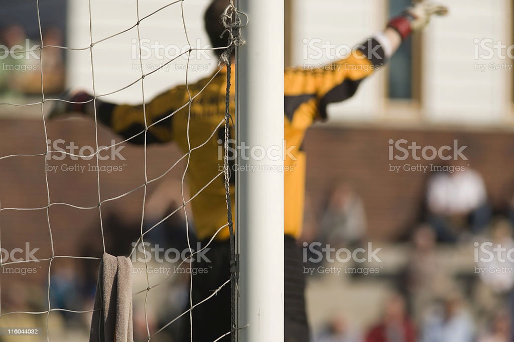goal post and net with a keeper out of focus royalty-free stock photo