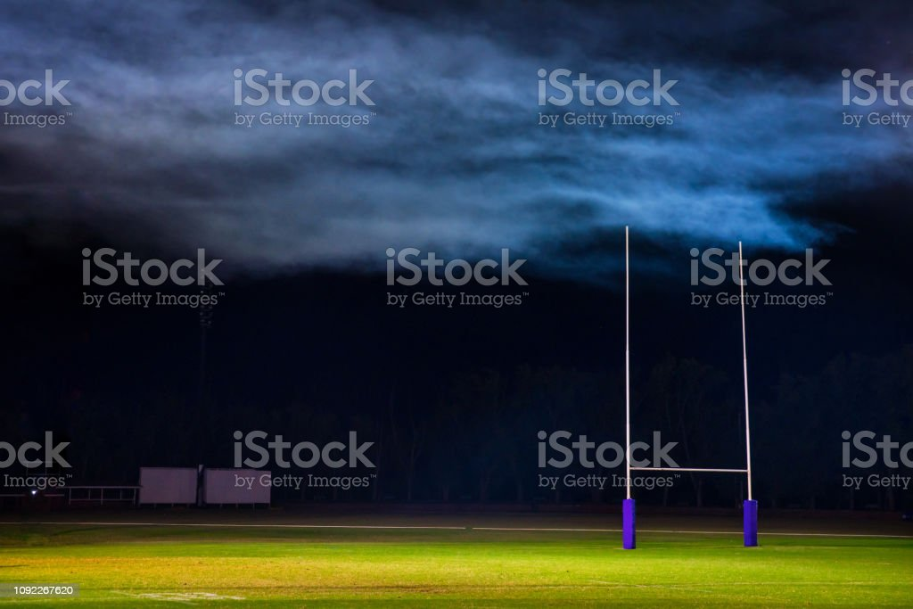 Goal posts for football, rugby union or league on field at night....