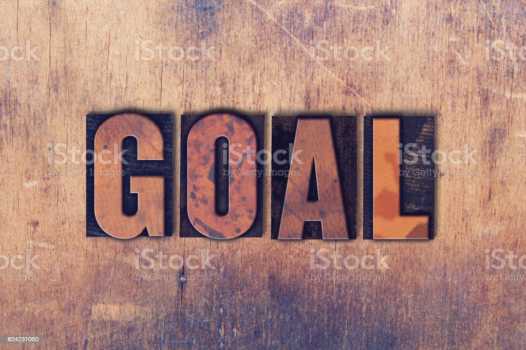 Goal Theme Letterpress Word on Wood Background stock photo