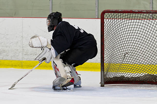 Goalie in his net during an ice hockey game stock photo