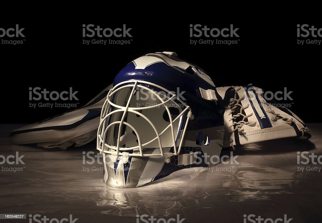 Goalie mask and gloves royalty-free stock photo