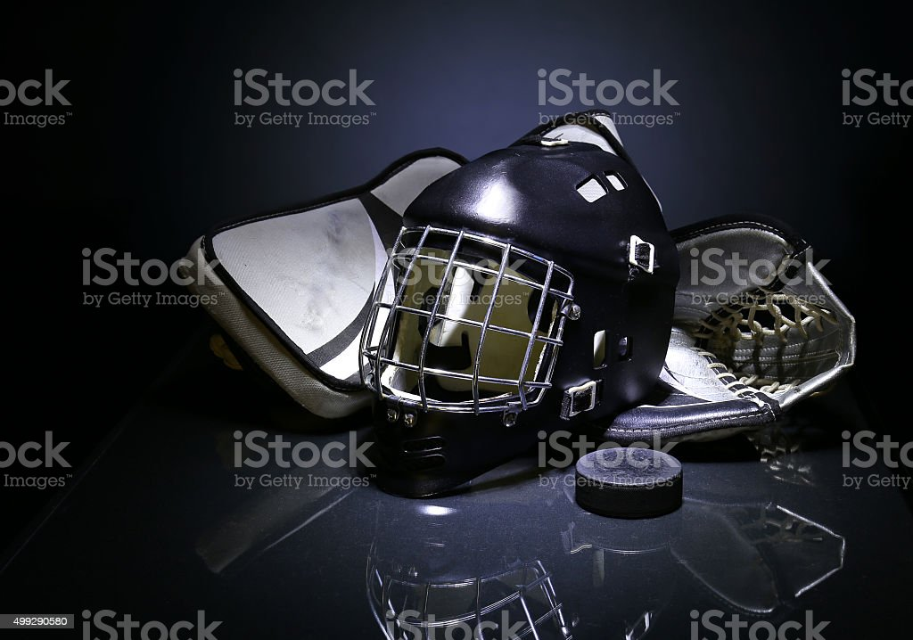 Goalie mask and gloves stock photo