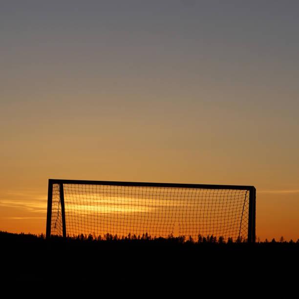 Målvakt Solnedgång bildbanksfoto