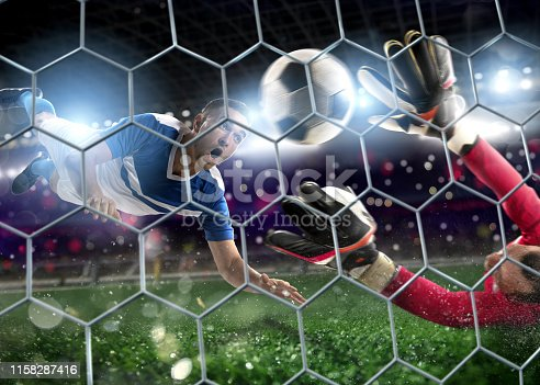 istock Goalkeeper catches the ball in the stadium during a football game 1158287416