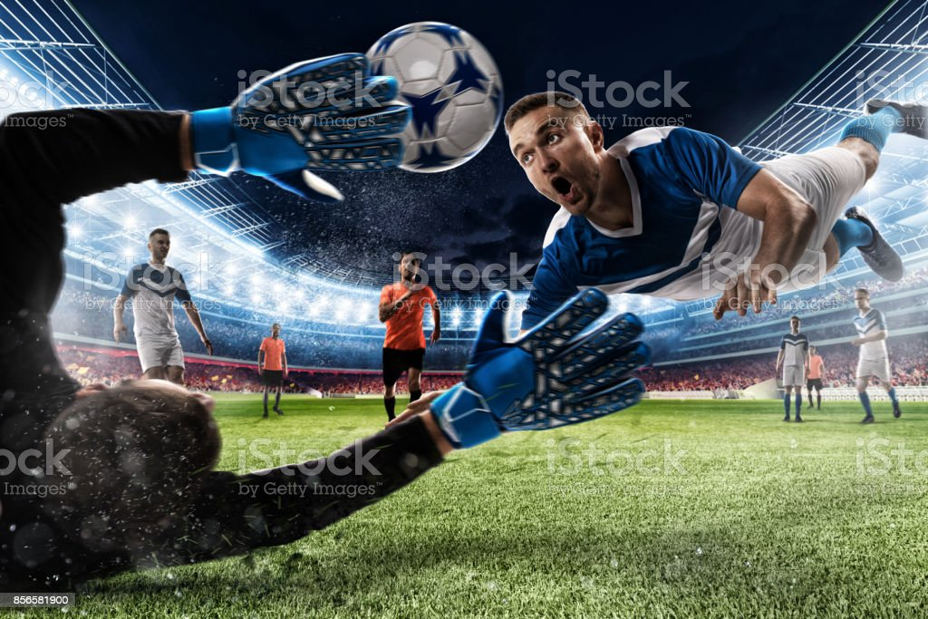 Goalkeeper catches the ball in the stadium foto stock royalty-free