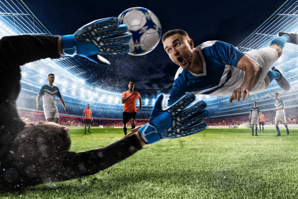 Goalkeeper catches the ball in the stadium - foto stock