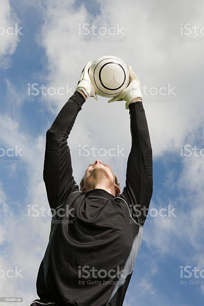 A goalkeeper catching a football 免版稅 stock photo