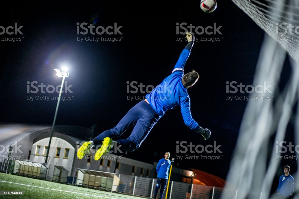 Goalkeeper Catching the Ball in Mid Air.