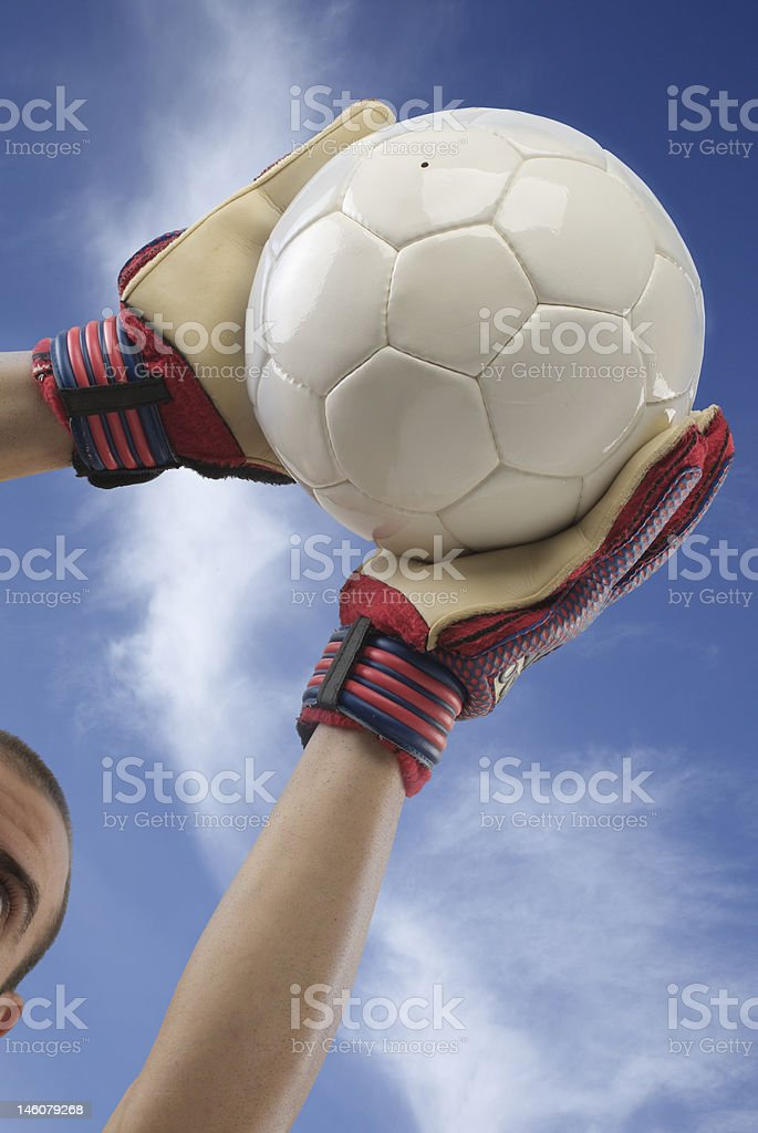 goalkeeper catching the ball royalty-free stock photo