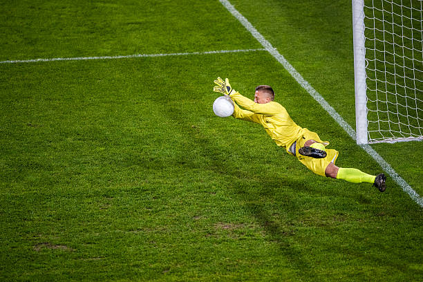 goalkeeper diving - professional sport stock photos and pictures