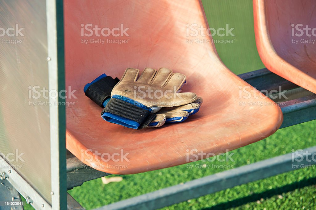 Goalkeeper Gloves On The Bench royalty-free stock photo