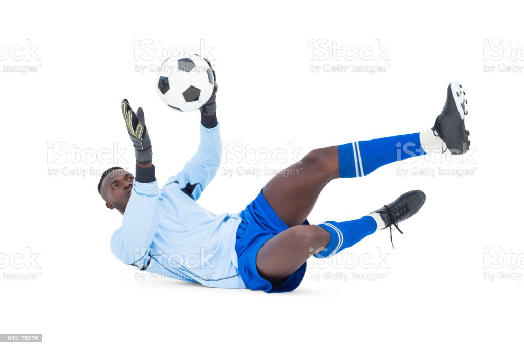 Goalkeeper in blue making a save stock photo